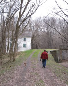 Level Walker and dog on towpath
