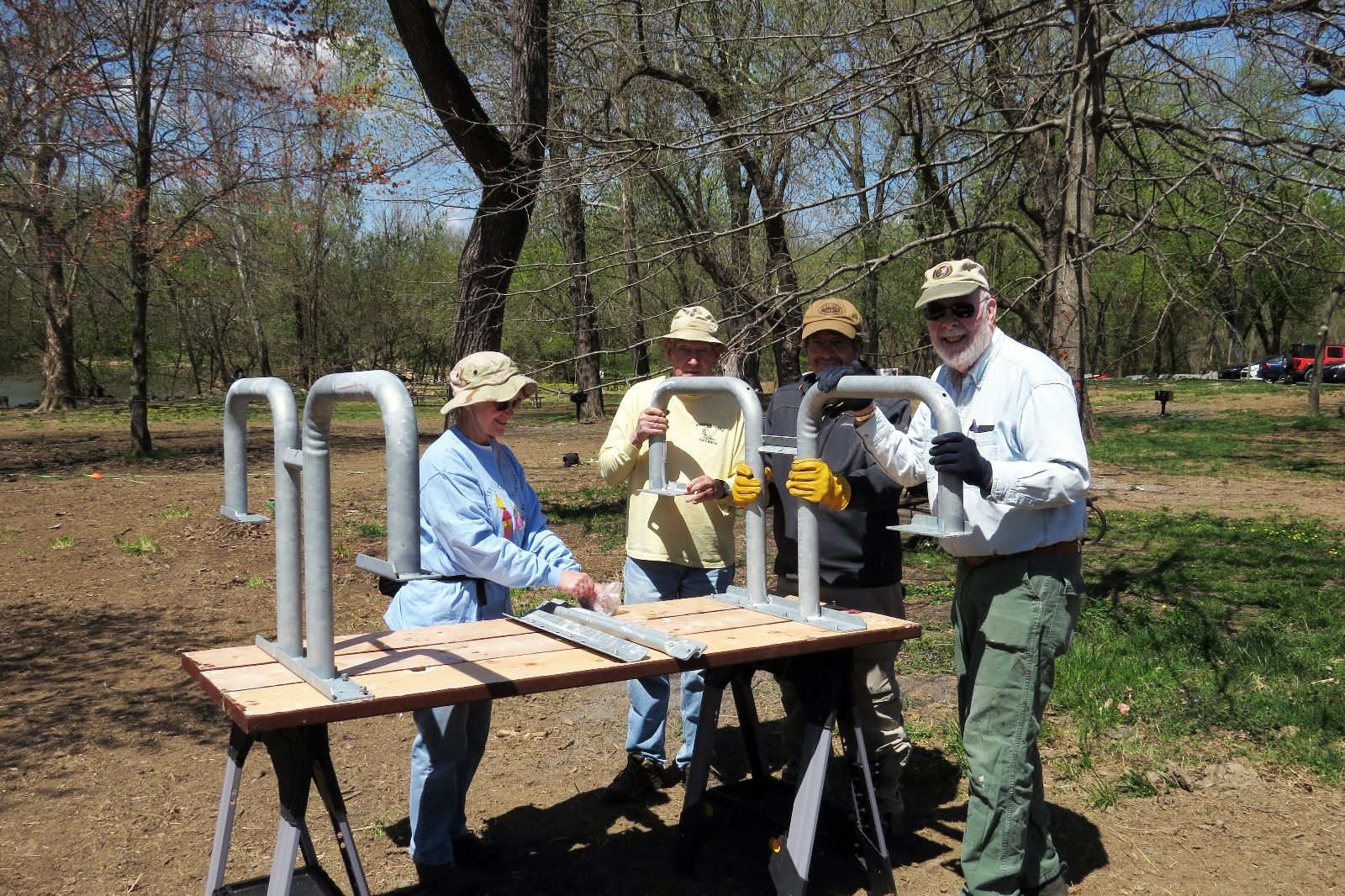 Volunteers assemble picnic table