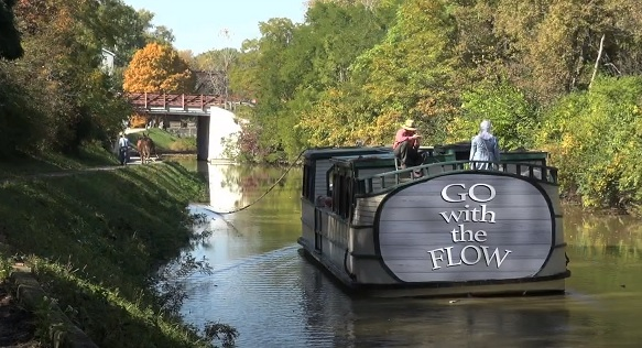 """Canal boat entitled """"Go with the Flow"""""""